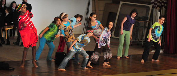 Newburyport: Students from the Inn Street Montessori Upper Elementary and Middle School perform a dance number to a medley of Beatles songs on Wednesday morning. They were at the annual Peace Gathering in the auditorium of Newburyport City Hall and presented by the Newburyport and Inn Street Montessori Schools. Bryan Eaton/Staff Photo
