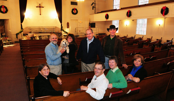 Newburyport: Organizers of Belleville Roots Music Series, front from left, Brenday Marshall, Bob and Diane Crofts and Marcia Samuelson. Back, from left, Ken Irwin, Annie, Donna Wilson Irwin, Rev. Ross Varney and Conrad Willeman. Bryan Eaton/Staff Photo