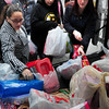 Newburyport: Students from the Newburyport High alternative education class drop off presents they've worked to collect at the Salvation Army on Thursday afternoon. Bryan Eaton/Staff Photo