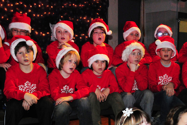 "Amesbury: Cashman School students sing ""White Christmas"" during dress rehearsal Wednesday afternoon for their Cashman Holiday Concert. The theme this year is Let It Snow with performances for the school body this morning and parents tonight at 7pm. Bryan Eaton/Staff Photo"