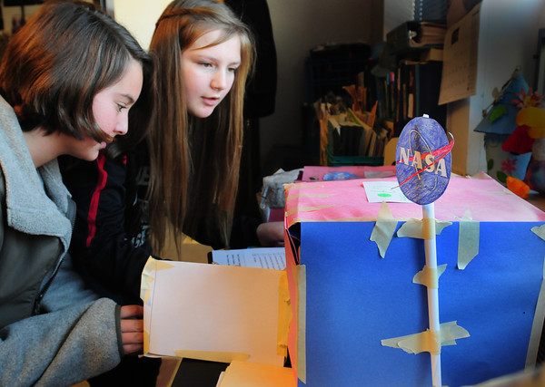 Amesbury: Students in Gale Regis's science class at Amesbury Middle School were charged with designing a moon habitat model using different data supplied by NASA. Then the students judged each other models, here, Brinn Martin, 12, left and Delaney Dow, 11. Bryan Eaton/Staff Photo