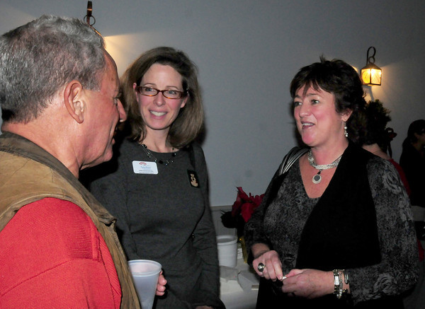 Amesbury: Amesbury Chamber of Commerce and Industrial Foundation chairman, Anne Bonaventura, center, introduces new president Marcy Quill to Amesbury resident Louis Rubenfeld at last night's 14th Annual Holiday Restaurant Showcase. Bryan Eaton/Staff Photo