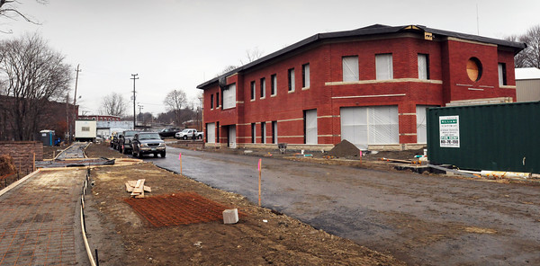 Amesbury: The Costello Transportation Center is taking shape in Amesbury's Lower Millyard. This view is the entrance of the building, which is in back from the street view, with the continuance of the Riverwalk at left. Bryan Eaton/Staff Photo