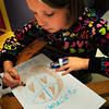 Salisbury: Noel Murphy, 9, makes a peace poster at the Boys and Girls Club in Salisbury on Wednesday. She and some friends were also making bracelets to sell as gifts. Bryan Eaton/Staff Photo