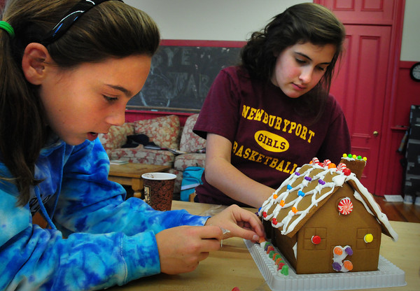 Newburyport: Michelle Thibault, 13, left and Stephanie Harrison, 14, work on a gingerbread house on Monday afternoon. They were at the Kelley School Teen Center in Newburyport after getting out of school. Bryan Eaton/Staff Photo