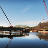 Amesbury: The crane at right hoists concrete to one of the piers for the new Hines Bridge being constructed in Amesbury. Bryan Eaton/Staff Photo