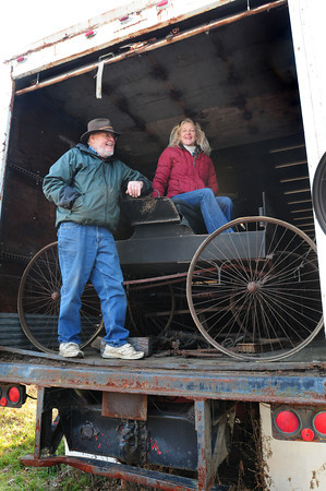 Amesbury: Richard Hale, vice president of the Carriage Museum's board in Amesbury, showed some of the groups carriages to Christine Miller that are stored in two trailers next the museum in the Lower Millyard. The group is hoping to bring back a Carriage Festival that would be held at Miller's Bob Lyn Stables. Bryan Eaton/Staff Photo