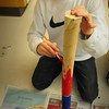 Salisbury: Salisbury Elementary School fifth-grader paints a rain stick in Beth Sayre-Scibona's class on Wednesday afternoon. The students were learning the seven principles of the African-American holiday Kwanzaa and doing projects related to them. Bryan Eaton/Staff Photo