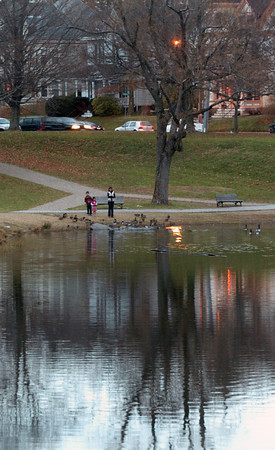 Newburyport: Mid-week was good weather for ducks which these people are feeding at the Frog Pond at the Bartlet Mall in Newburyport. Today will be breaking of any rain to become sunny, though cooler. Bryan Eaton/Staff Photo