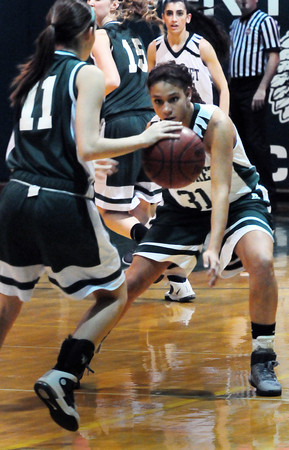 West Newbury: Pentucket's Sarah Higgins keeps her eye on a Billerica player as she moves down court. Bryan Eaton/Staff Photo