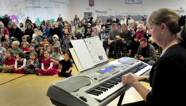"""Newburyport: Brown School music teacher Sue Conte invited parents to sing along with children at the school's winter concert on Tuesday afternoon, singing """"We Wish You a Merry Christmas"""", some verses alternating """"Kwanzaa"""" and """"Hannukkah"""". Bryan Eaton/Staff Photo"""