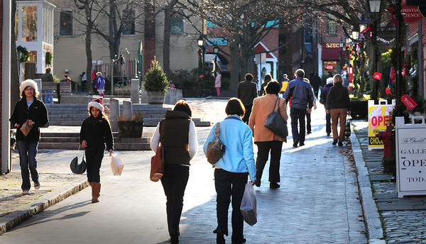 Newburyport: Inn Street was busy with shoppers yesterday afternoon, though temperatures were a little cooler. The downtown was especially busy as the Newburyport School system had a half day. Bryan Eaton/Staff Photo