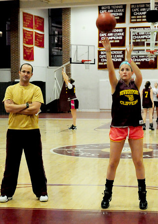 Newburyport: Newburyport girls basketball coach Gregg Dollas watches as his team, here, Molly Rowe, practices foul shots. Bryan Eaton/Staff Photo