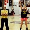 Newburyport: Newburyport girls basketball coach Gregg Dollas watches as his team, here, Molly Rowe, practices foul shots. Bryan Eaton/Staff Photo