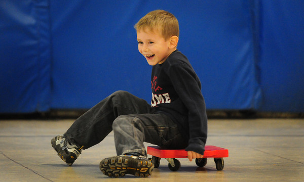Amesbury: Sam Guimaraes, 5, glides along at Amesbury Elementary School yesterday morning. He was in a roller race in gym class.  Bryan Eaton/Staff Photo