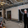 Amesbury: Annmary Connor, director of the Amesbur Council on Aging shows off the Great Room of the new senior center which will be housed in the Costello Transportation Center. The room will be used for gatherings and meals, the new kitchen is back, left, of photo. Bryan Eaton/Staff Photo