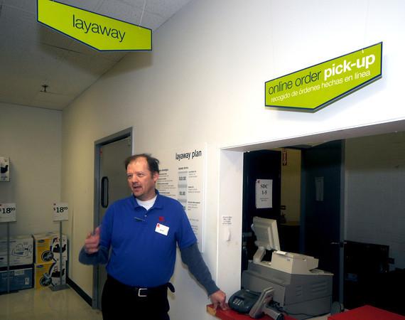 Newburyport: KMart employee Mark Beaudoin talks about a customer paying off layaway balances of other customers at the Newburyport store. Jim Vaiknoras/staff photo