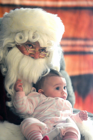 Salisbury: Lilian Condelli, 6 month, visits with Santa at the annual Breakfast with Santa at the Hilton Center in Salisbury Saturday morning.The event is sponsered by teh Salisbury Fire Dept.  Jim Vaiknoras/Staff photo