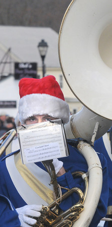 Merrimac: Patrick Slack plays sousaphone as he marches with the Georgetown High band in  the annual Merrimac Santa Parade Sunday afternoon. Jim Vaiknoras/staff photo