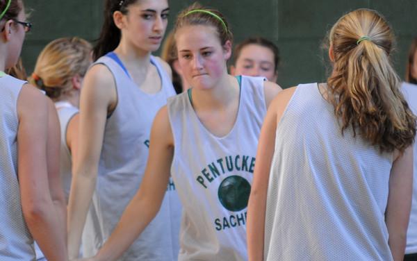 West Newbury: Pentucket's Leigh McNamara greets her teammates. Staff photo