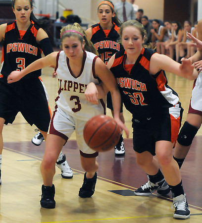 Newburyport: Newburyport's Lea Tomasz and Ipswich's Julia Davis fight for a loose ball during Institution for Savings 8th annual Holiday Tournament at Newburyport High. Jim Vaiknoras/staff photo