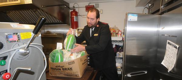 Salvation Army lieutenant Jeff Brunelle loads donated turkeys into the frezer at the Salvation Army in Newburyport. Jim Vaiknoras/staff photo