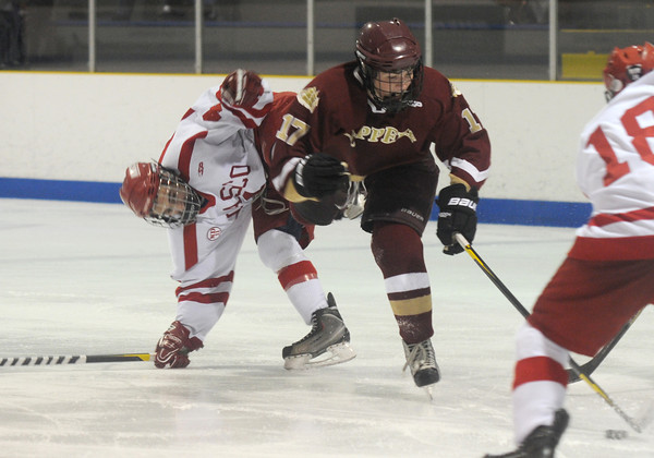 Haverhill: Newburyport's Cooper Hines gets tangled with Masco's Trevor Surette during their game at the Valley Forum in Haverhill. Jim Vaiknoras/staff photo