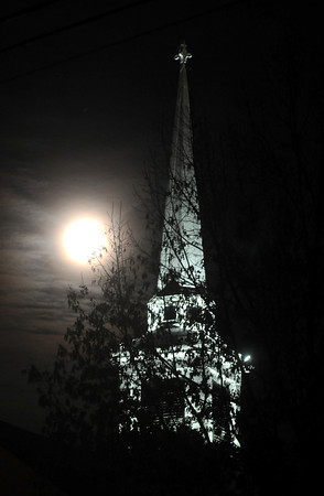 Seabrook: The full moon rises next to the steeple of the Trinity United Church in Seabrook. Light were recently installed illuminating the church for the first time. Jim Vaiknoras/staff photo