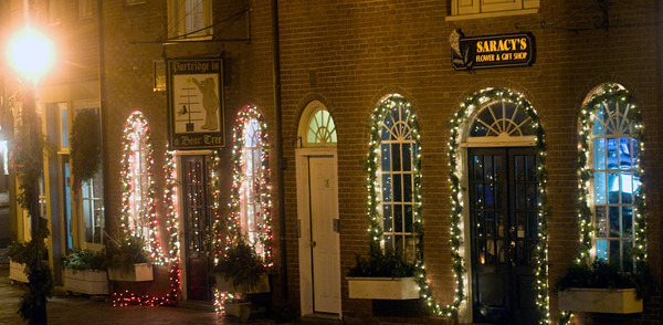 Newburyport:Shops on East Row in Market Square in Newburyport are lite up for the holidays. Jim Vaiknoras/staff photo