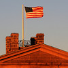 Newburyport: The top of the Newburyport Maritime Museum catches the warm afternoon light as the flag flyes in the cold winter wind. Jim Vaiknoras/staff photo