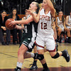 Newburyport: Pentucket's Nicole Viselli is fouled by Newburyport's Molly Rowe during their game at Newburyport high Monday night. Jim Vaiknoras/staff photo