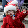 Merrimac: Lauren Talbot, 2, and her twin sister Ellison were all dress up for Christmas as they watch the annual Merrimac Santa Parade Sunday afternoon. Jim Vaiknoras/staff photo