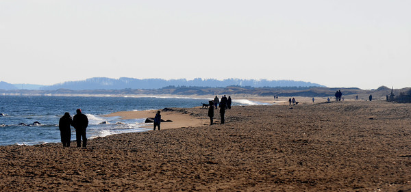 newbury: People brave the December wind on a cold windy day on Plum Island. Staff photo