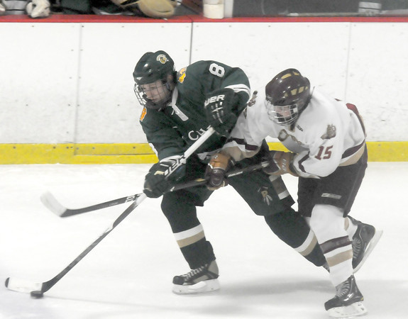 Newburyport: Pentucket's Bob Barry fights for the puck with Newburyport's Timothy Brennan during their game at the Graf Rink in Newburyport Wednesday night. JIm Vaiknoras/staff photo