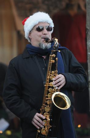 Amesbury: Ed Justen, AKA EJ Smooth, plays Holiday songs at Saturday's Amesbury Christmas Parade. Jim Vaiknoras/staff photo