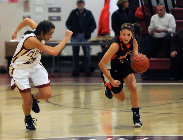 Newburyport:  Ipswich's Masey Zegarowski is guarded by Newburyport's Cady Bennett as she brings the ball up court during Institution for Savings 8th annual Holiday Tournament at Newburyport High. Jim Vaiknoras/staff photo