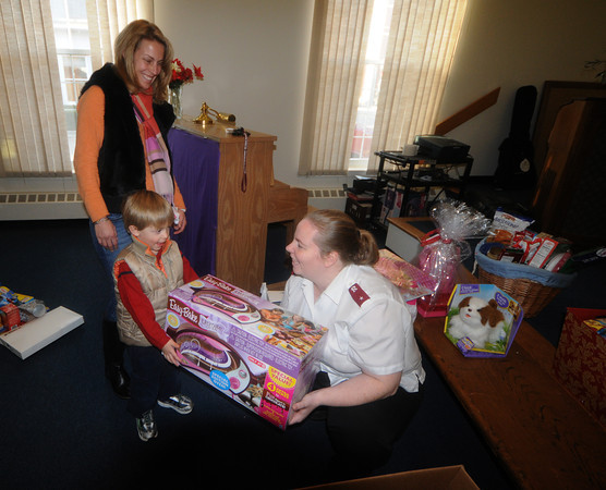 Newburyport: Jack Ide, 3, and his mom anna make a donation to Salvation Army lieutenant Meghan Brunelle at the Salvation Army in Newburyport: JIm Vaiknoras/staff photo