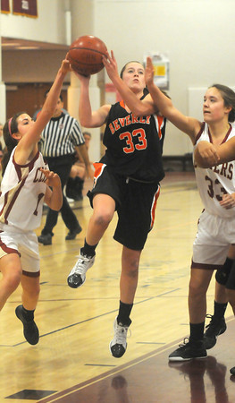 Newburyport: Beverly's Mary Cate Flaherty drives to the basket Sunday night at Newburyport High. Jim Vaiknoras/staff photo