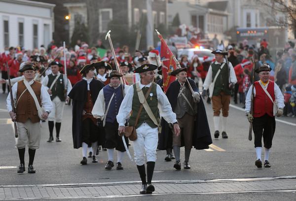 Amesbury: The Acton Minutemen march in Saturday Amesbury Christmas Parade. Jim Vaiknoras/staff photo