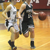 Topsfield: Pentucket's Alex Moore drives past Westford Academy's Meghan Kibblehouse during their game at the Masconomet Holiday Invitational. Jim Vaiknoras/staff photo