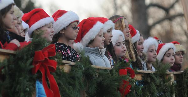 Newbury: The select choir from the Newbury Elementary School sing holiday songs at the annual Tree lighting on the Newbury Upper Green Sunday. Jim Vaiknoras/staff photo