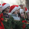 Newbury: The select choir from the Newbury Elementary School sing holiday songs at the annual Tree lighting on the Newbury Upper Green Sunday. Jim Vaiknoras/staff photo