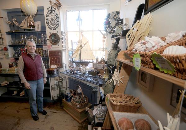 Newburyport: Diane Gronbeck co-owner of Brass Lion in Market Square Newburyport. Jim Vaiknoras/staff photo