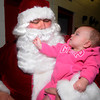 Salisbury: Ava Harrison, daughter of Salisbury firefighter Greg Harrison, checks out Santa's beard before he headed out on a fire truck to visit the good people of Salisbury Friday night.Jim Vaiknoras/staff photo