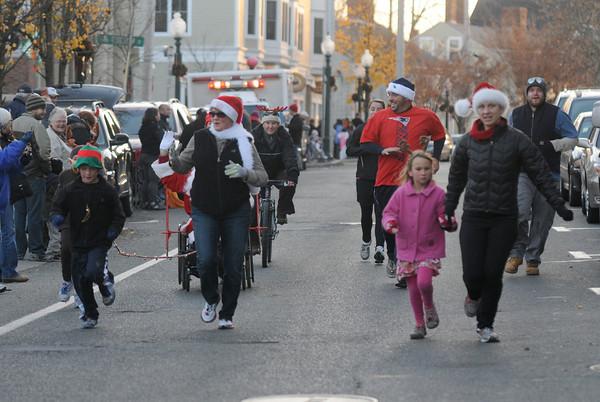 Amesbury: Runners lead the way at Saturday's Amesbury Christmas Parade. Jim Vaiknoras/staff photo