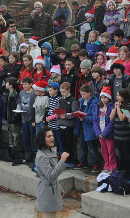 Amesbury: Music teacher Alicia Terrell leads Amesbury Elementary School Choir  as they perform at the Al Capp Amphitheater in the Millyard in Amesbury Thursday afternoon. . JIm Vaiknoras/staff photo