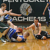 West Newbury: Pentucket's Josh Creamer and Parker Kelly converge on Georgetown's Mike Bjork as they scramble for a loose ball in the River Rival Boys Basketball Tournament Final at Pentuckey Friday night. Jim Vaiknoras/staff photo