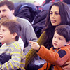 Newbury: Mindi Poston Gay enjoys the songs of Marcus Gale with her sons Parker and Bowden at the Newbury library Saturday morning. Jstaff photo