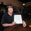 Georgetown: Dawn Poussard at Rory O'Connor's Irish Pub, she used a plea on the pubs menus to help raise money to buy furniture for a homeless family who recently got a federally-funded apartment. Jim  Vaiknoras/staff photo