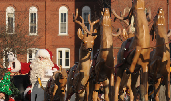 Merrimac: St Nick waves to the crowd at the annual Merrimac Santa Parade Sunday afternoon. Jim Vaiknoras/staff photo